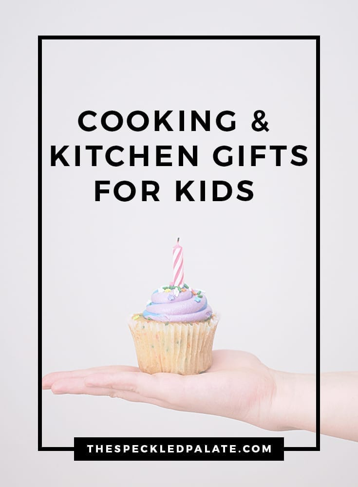 A child holds a purple-frosted cupcake in the palm of their hand with the text 'cooking & kitchen gifts for kids'