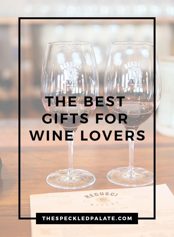 Two wine glasses on a wooden bar with the text 'the best gifts for wine lovers'