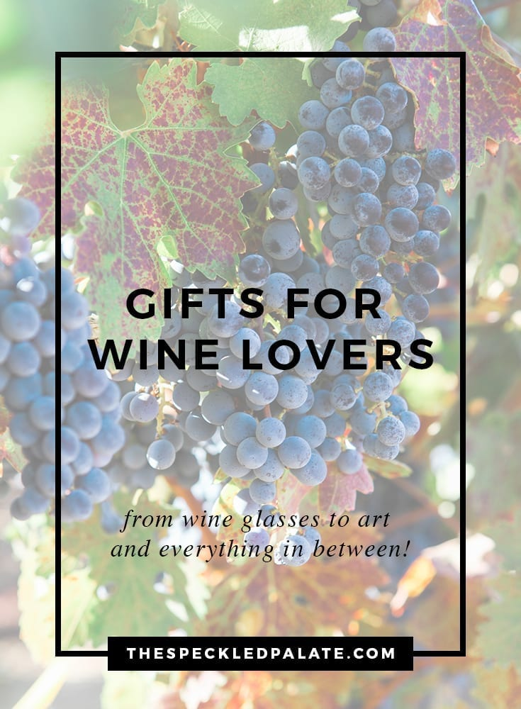 A bunch of wine grapes on a vine with the text 'gifts for wine lovers'
