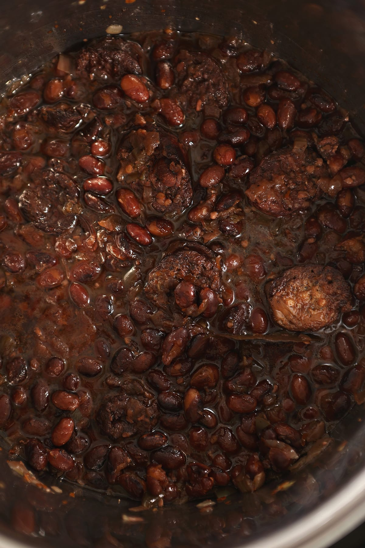 Cooked Red Beans with sausage in the bowl of the Instant Pot