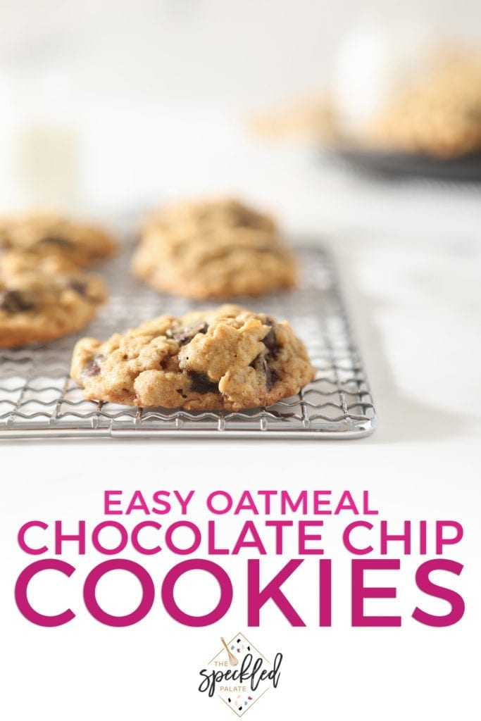 A oatmeal chocolate chip cookie on a wire cooling rack with other cookies behind it with the text 'easy oatmeal chocolate chip cookies'