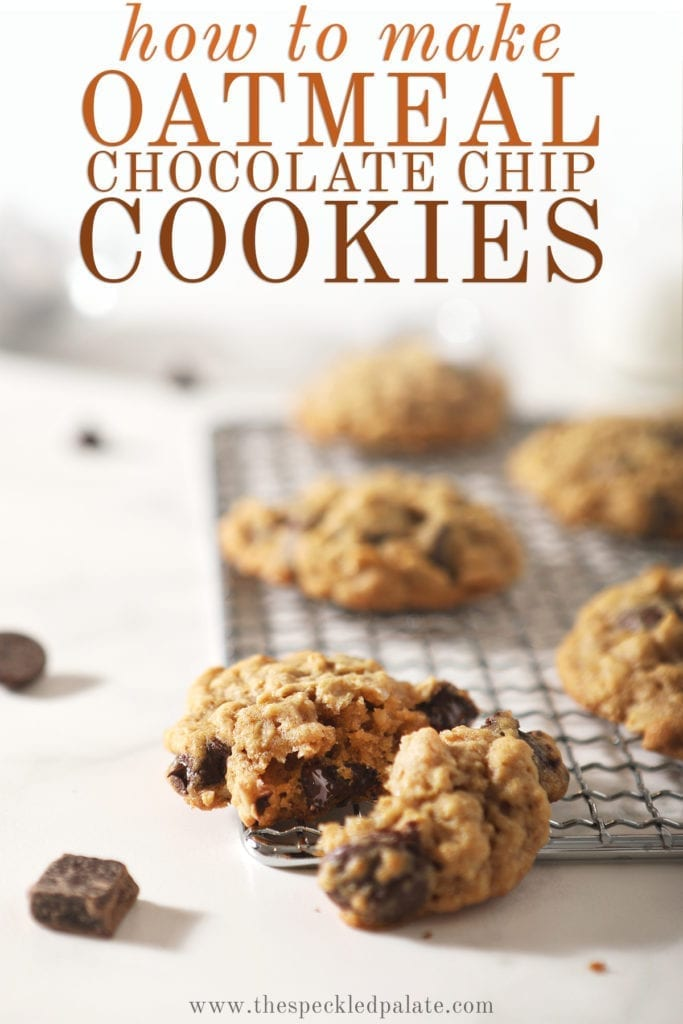 A halved oatmeal chocolate chip cookie on a wire cooling rack with other cookies behind it with the text 'how to make oatmeal chocolate chip cookies'