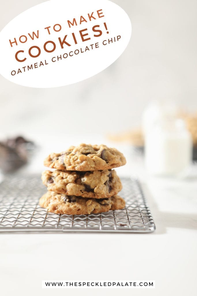 Three oatmeal chocolate chip cookies stacked on top of each other on a wire cooling rack with the text 'how to make cookies! oatmeal chocolate chip'