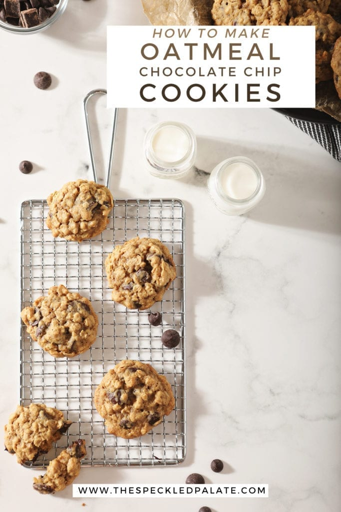 Several cookies on a wire cooling rack with milk around them with the text 'how to make oatmeal chocolate chip cookies'