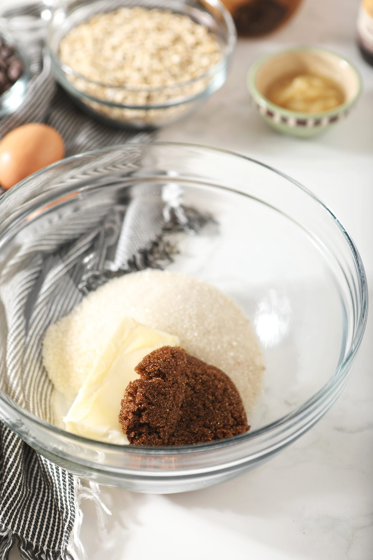 Granulated sugar, brown sugar and butter in a bowl