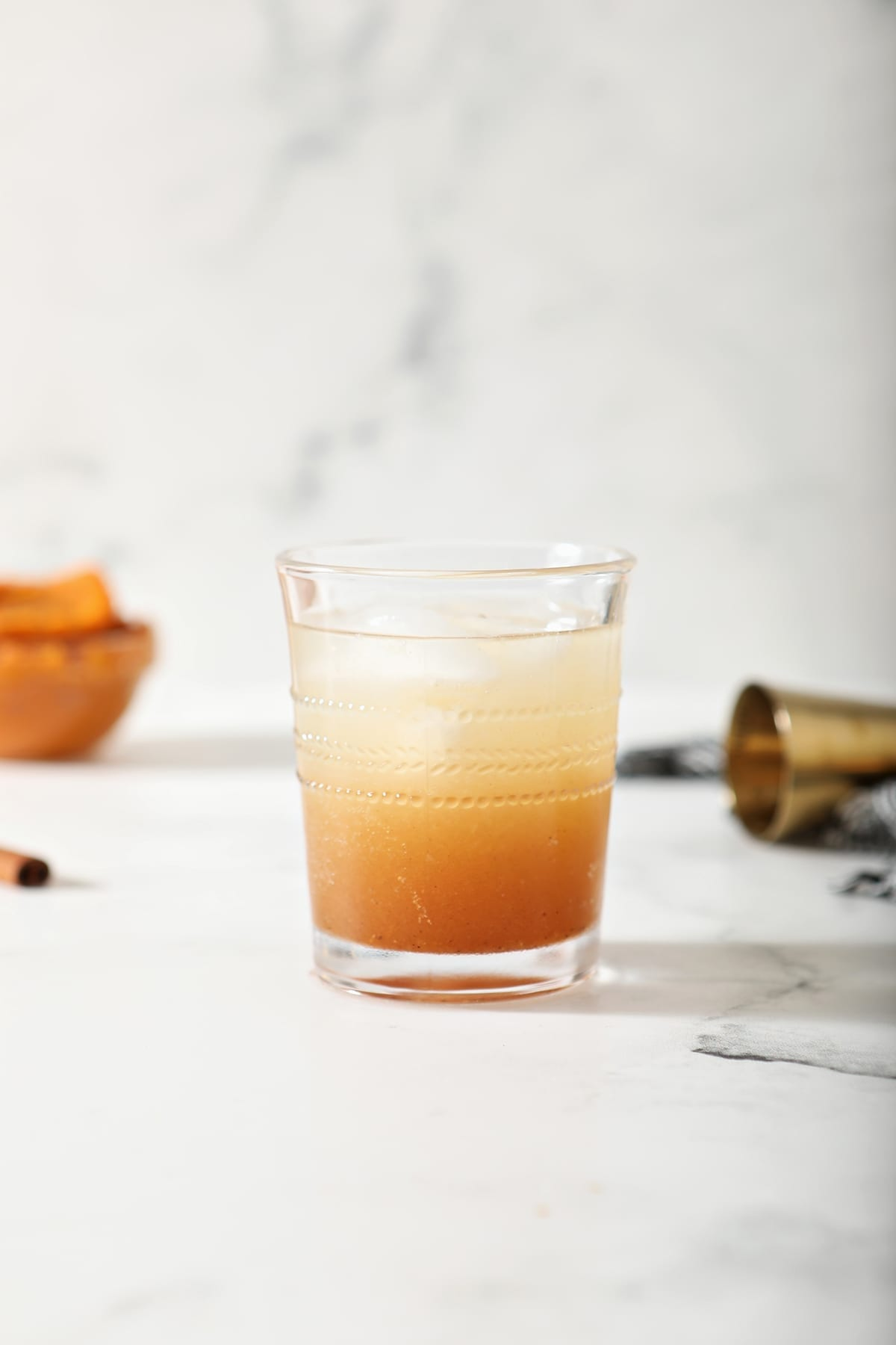 A glass of Pumpkin Spice Moscow Mule on marble, before garnishes are added