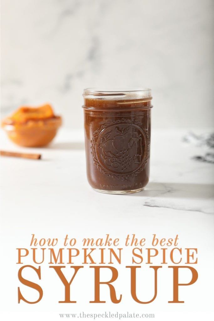 A jar of Pumpkin Spice Syrup sits on marble with a cinnamon stick and pumpkin puree behind it with the text 'how to make the best pumpkin spice syrup'