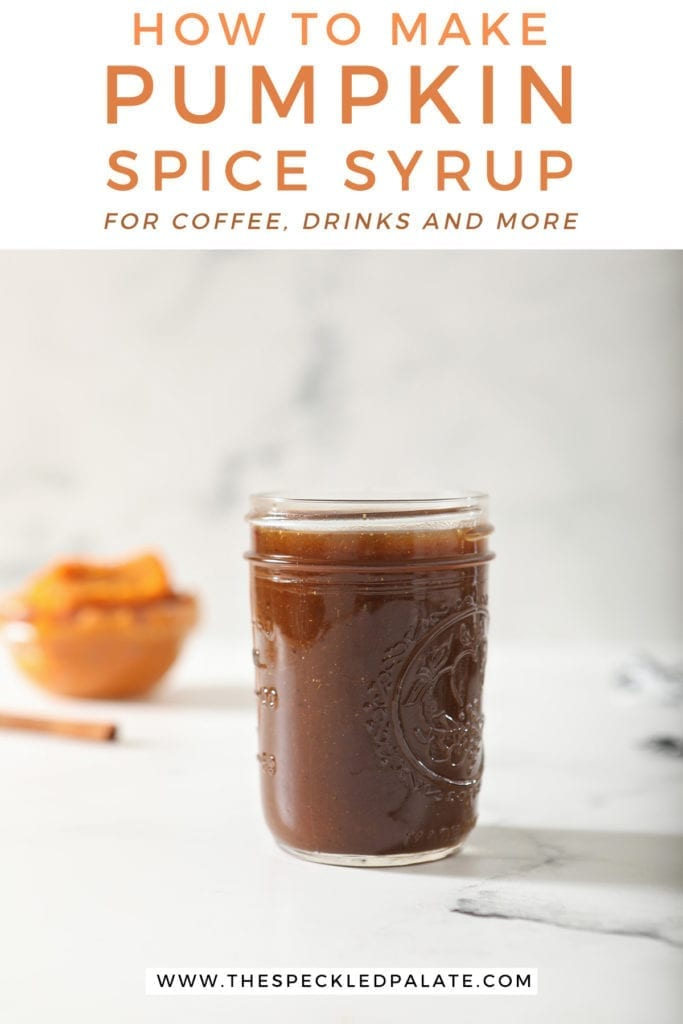 A jar of Pumpkin Spice Syrup sits on marble with a cinnamon stick and pumpkin puree behind it with the text 'how to make pumpkin spice syrup for coffee, drinks and more'