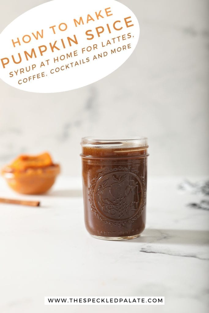 A jar of Pumpkin Spice Syrup sits on marble with a cinnamon stick and pumpkin puree behind it with the text 'how to make pumpkin spice syrup at home for lattes, coffee, cocktails and more'
