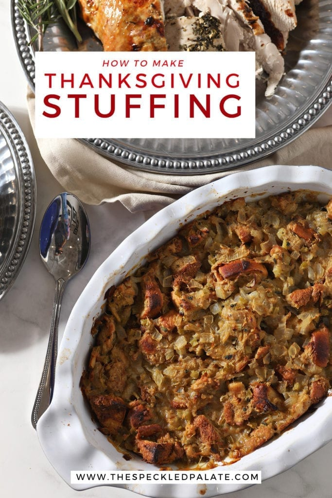 Brioche Bread stuffing in a casserole dish on the holiday table next to sliced turkey with the text 'how to make thanksgiving stuffing' on top of the image