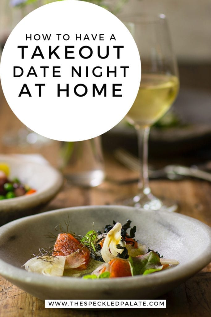 Close up of a bowl holding an intricate dish and a glass of white wine with the text 'how to have a takeout date night at home'