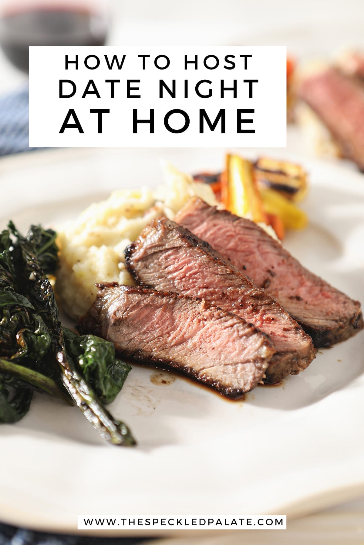 Close up of sliced ribeye on a plate with potatoes, greens and carrots with the text 'how to host date night at home'