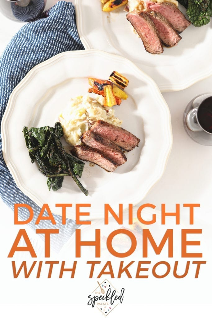 Sliced ribeye on a white plate with potatoes, greens and carrots with the text 'date night at home with takeout'