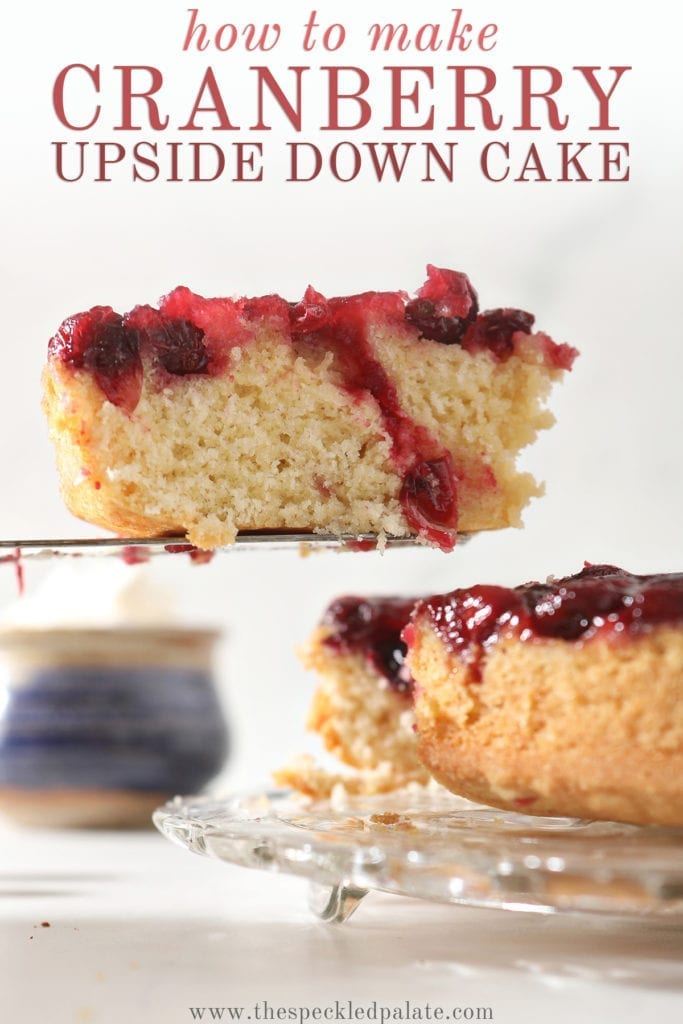 A slice of cake with a cranberry sauce topping is lifted from a cake plate with the text 'how to make cranberry upside down cake'