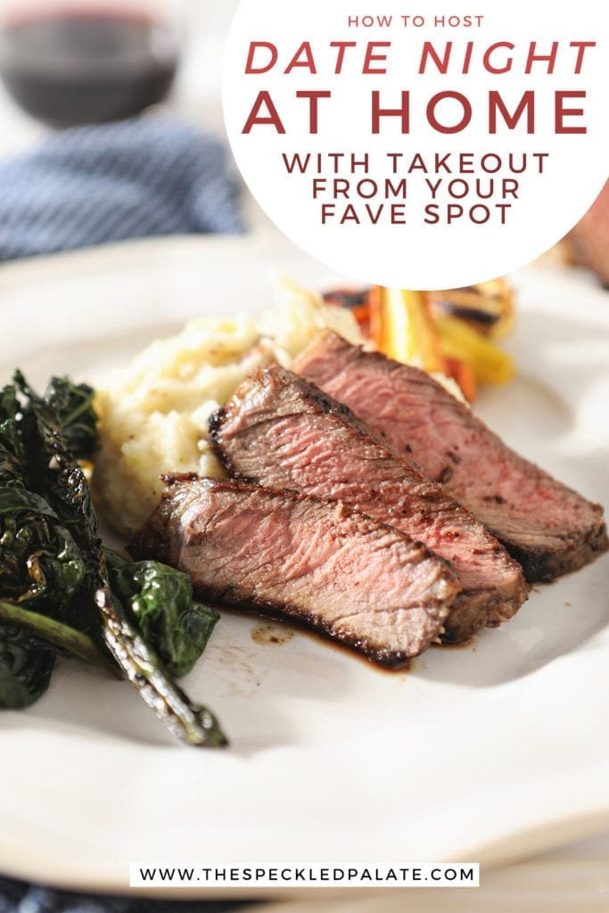 Close up of sliced ribeye on a plate with potatoes, greens and carrots with the text 'how to host date night at home with takeout from your fave spot'