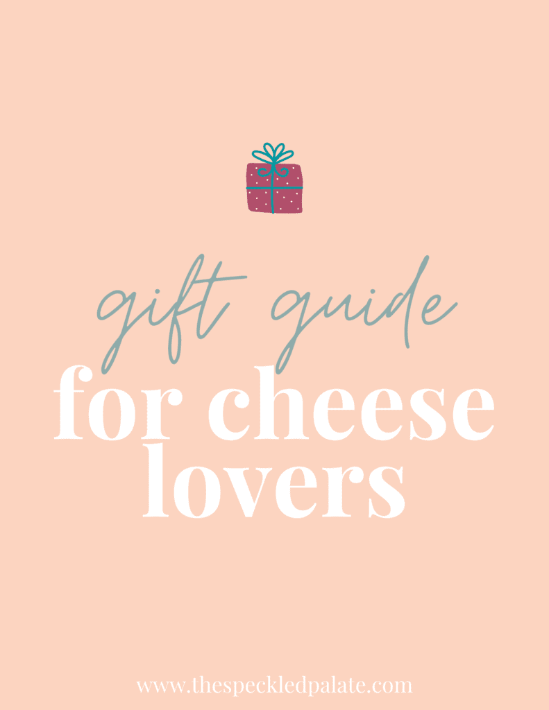 A graphic with the text 'gift guide for cheese lovers' with a colorful present on a peach background