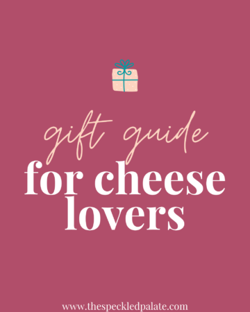 A graphic with the text 'gift guide for cheese lovers' with a colorful present on a pink background