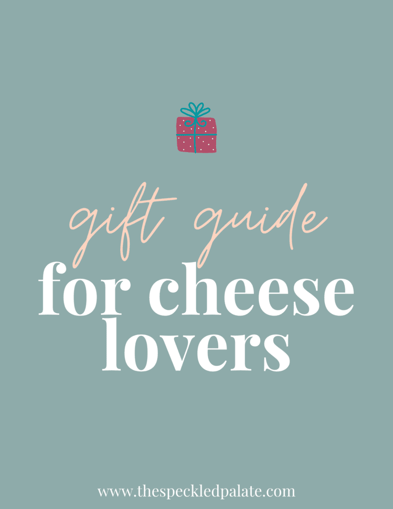 A graphic with the text 'gift guide for cheese lovers' with a colorful present on a teal background
