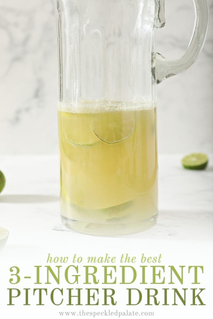 A Moscow Mule Pitcher with lime rounds inside the pitcher on marble with the text 'how to make the best 3-ingredients pitcher drink'