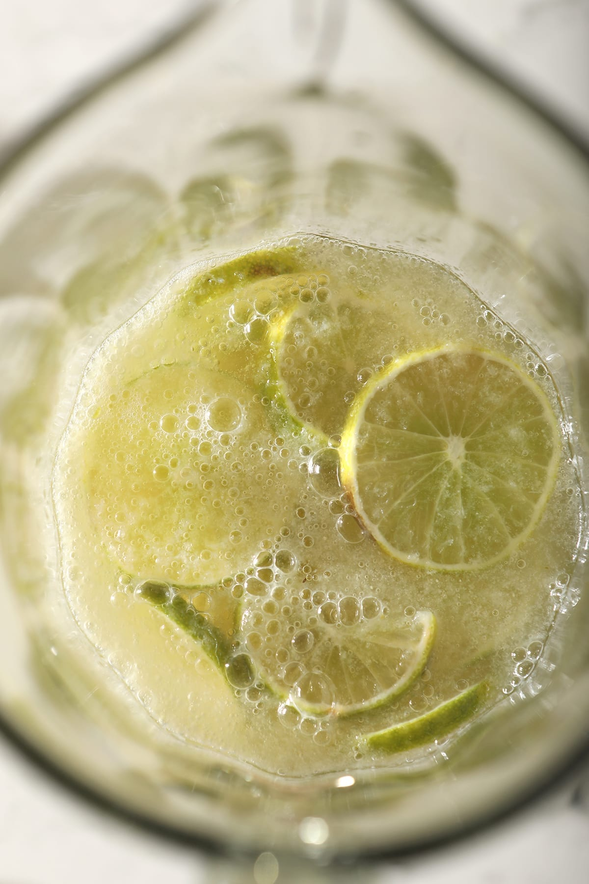 Close up of lime rounds and ingredients for a Moscow Mule pitcher