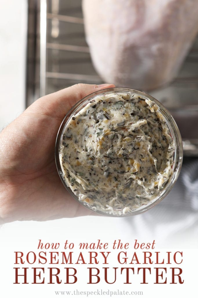 A hand holds a small glass bowl of compound butter above a raw turkey breast in a roasting pan with the text 'how to make the best rosemary garlic herb butter'