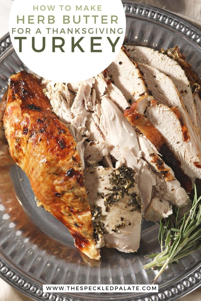 Close up of roasted turkey breast with herb butter on a silver platter with the text 'how to make herb butter for a thanksgiving turkey'