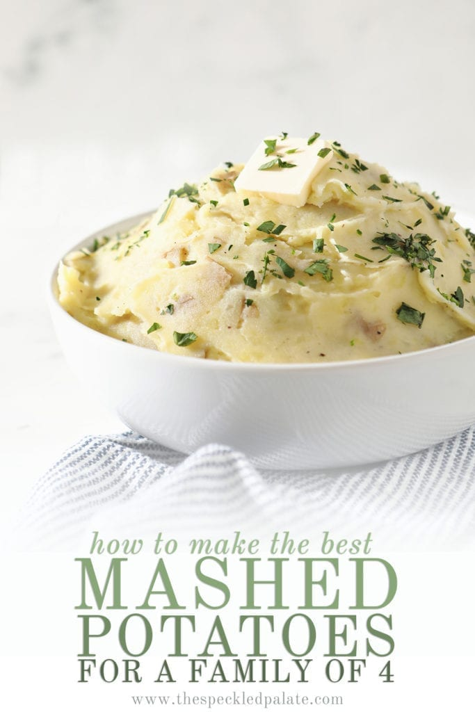 A white bowl holds a serving of creamy Homemade Mashed Potatoes while sitting on a blue and white striped towel with the text 'how to make the best mashed potatoes for a family of 4'
