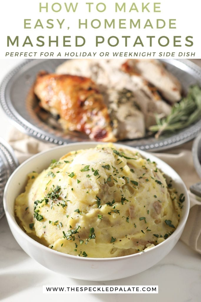 A bowl of mashed potatoes sits in front of a silver platter holding turkey, surrounded by other holiday dishes with the text 'how to make easy, homemade mashed potatoes. perfect for a holiday or weeknight side dish!'