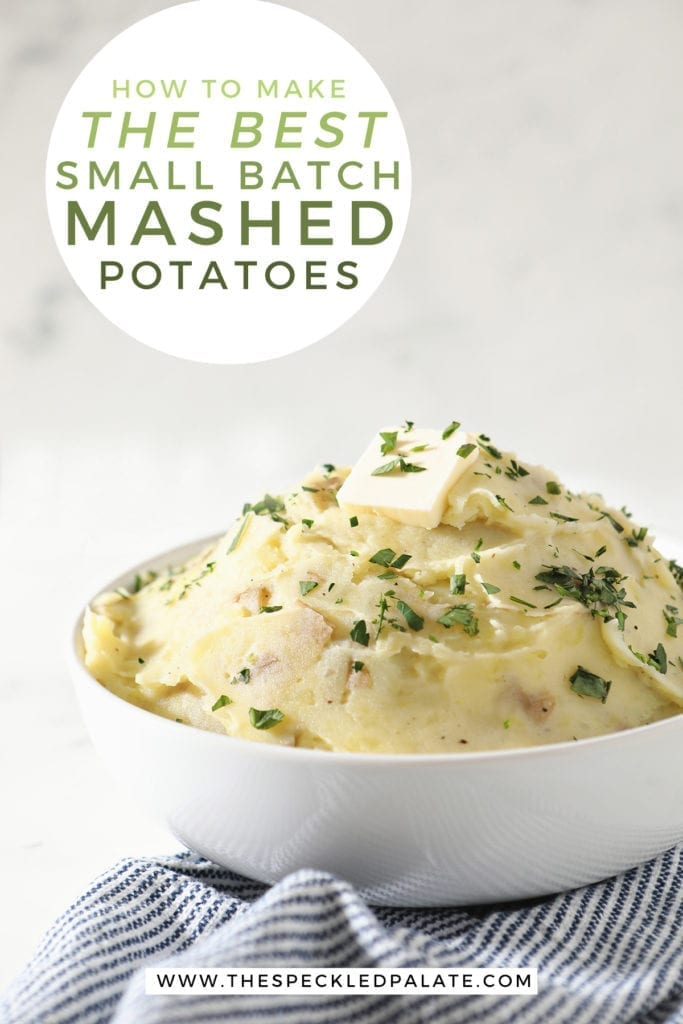 A white bowl holds a serving of creamy Homemade Mashed Potatoes while sitting on a blue and white striped towel with the text 'how to make the best small batch mashed potatoes'