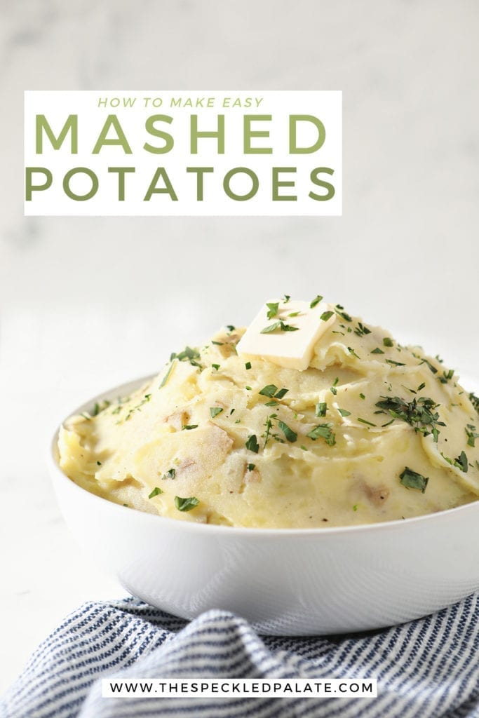 A white bowl holds a serving of creamy Homemade Mashed Potatoes while sitting on a blue and white striped towel with the text 'how to make easy mashed potatoes'