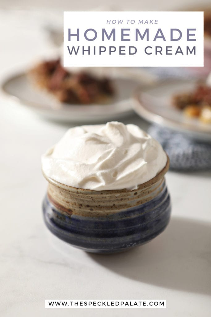 Close up of a blue pottery bowl holding a serving of homemade sweetened whipped cream with the text 'how to make homemade whipped cream'