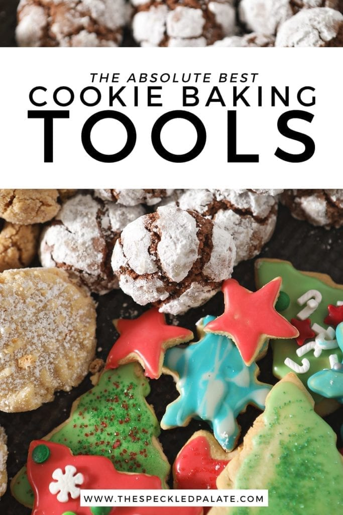 A tray of various cookies with the text 'the absolute best cookie baking tools'