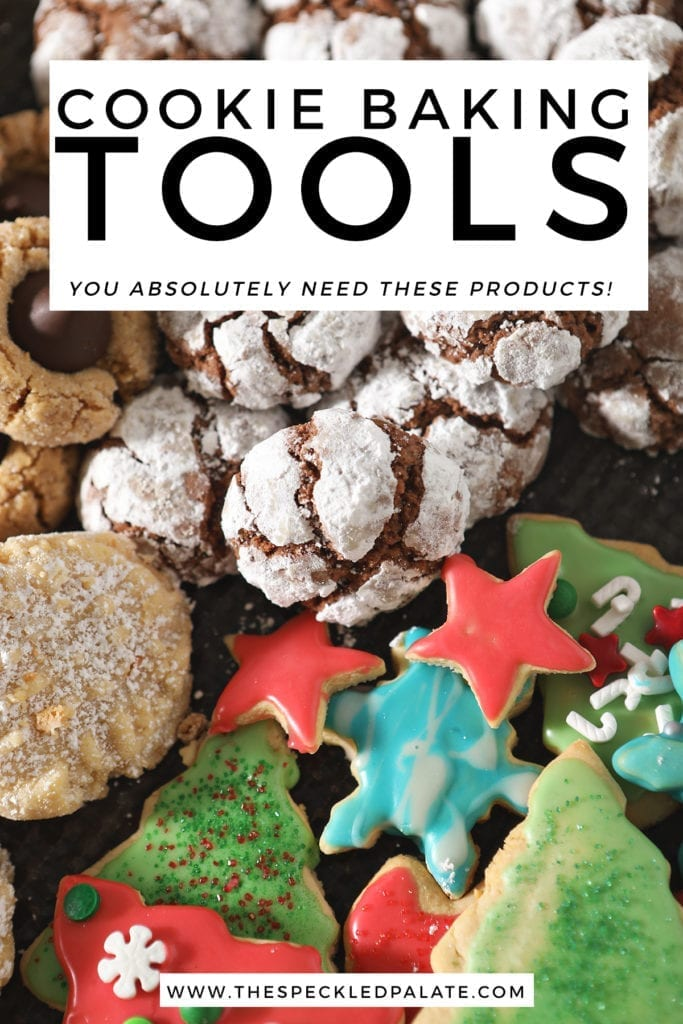 A tray of various cookies with the text 'cookie baking tools. you absolutely need these products!'