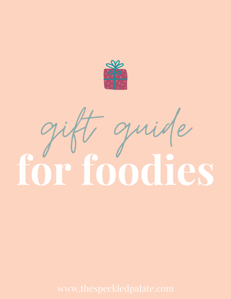 """A graphic with the text Gift Guide for Foodies"""" next to a present on a peach background"""