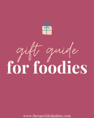 """A graphic with the text Gift Guide for Foodies"""" next to a present on a pink background"""