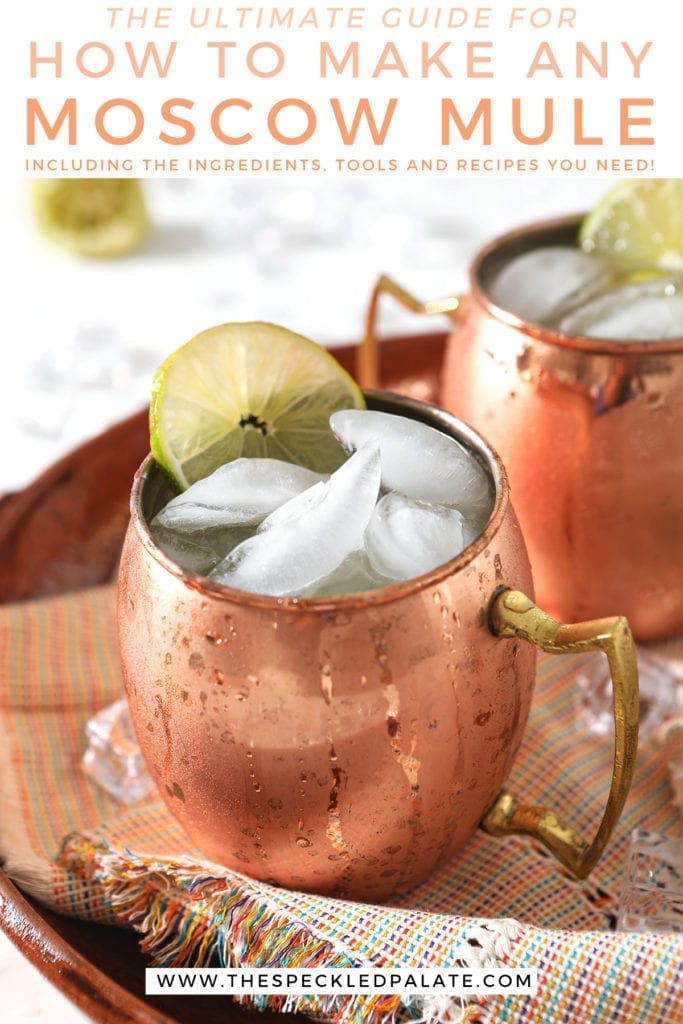 Two Mexican Mules in copper mugs on a rainbow-colored napkin with the text 'the ultimate guide for how to make any moscow mule including the ingredients, tools and recipes you need'