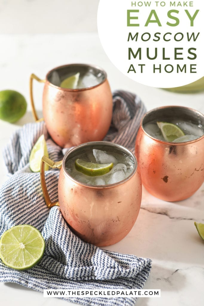 Three Mules in copper mugs sit on a marble surface next to a blue and white striped towel and lime wedges with the text 'how to make easy moscow mules at home'