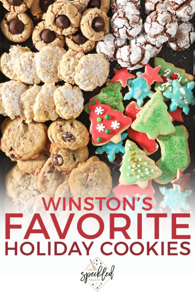 Close up of a red decorated tree sugar cookie and other cookies around it with the text 'winston's favorite holiday cookies'