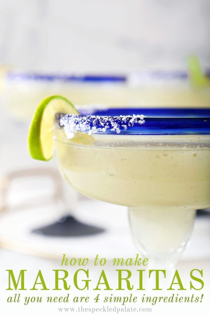 Close up of a lime twist on the salted rim of a margarita with the text 'how to make margaritas. all you need are 4 simple ingredients!'