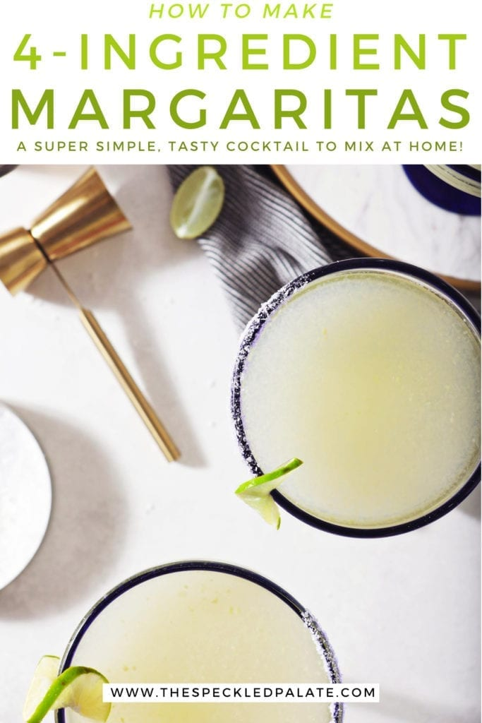 Three Cointreau margaritas sit on a marble counter next to a jigger, lime wedges and a container of salt with the text 'how to make 4-ingredient margaritas. a super simple, tasty cocktail to make at home!'
