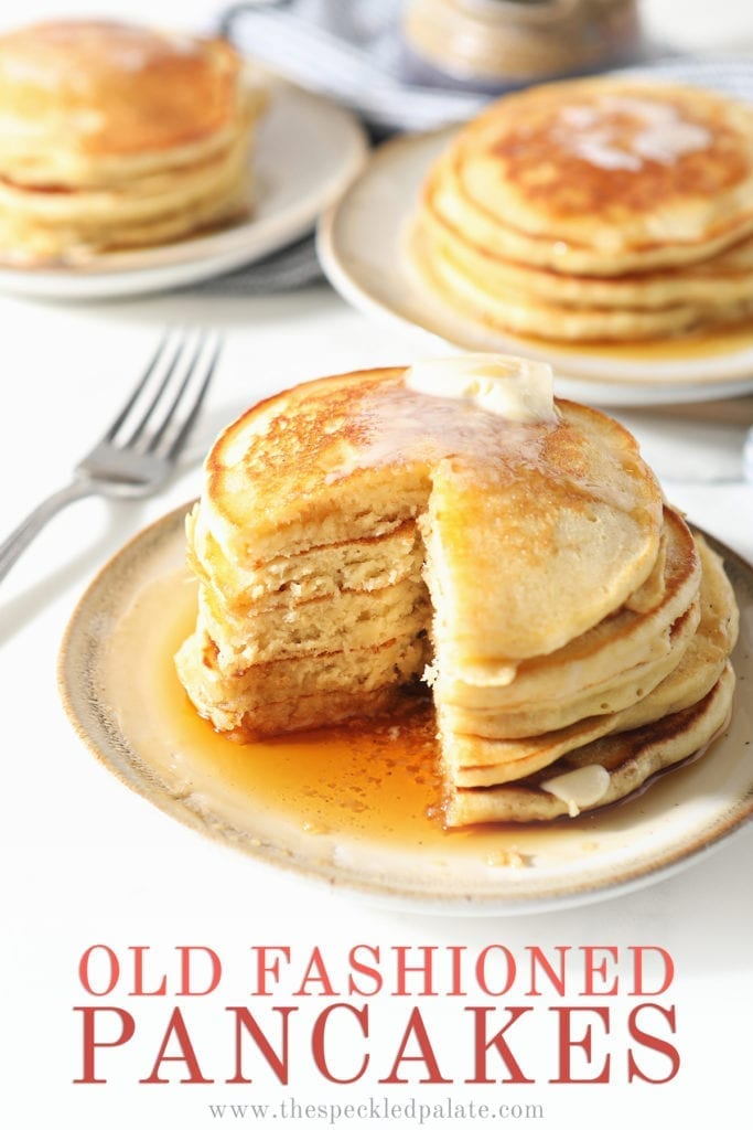 A stack of old fashioned homemade pancakes on a white plate with syrup and butter with a wedge cut out of it with the text 'old fashioned pancakes'