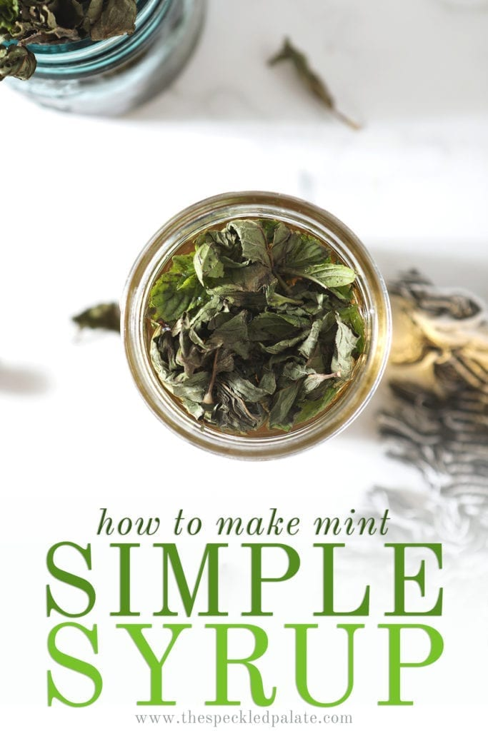 Mint leaves sit on top of a jar of simple syrup before being stirred in with the text 'how to make mint simple syrup'