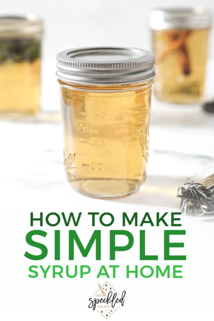 A mason jar holding regular simple syrup sits on front of two other jars holding mint simple syrup and cinnamon simple syrup on a marble surface with the text 'how to make simple syrup at home'