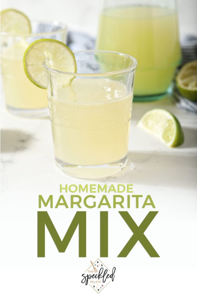 Two margaritas sit in front of a pitcher of homemade margarita mix with the text 'homemade margarita mix'