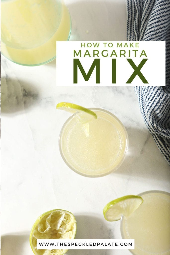 Two glasses garnished with lime rounds sit next to a pitcher of homemade margarita mix with the text 'how to make margarita mix'