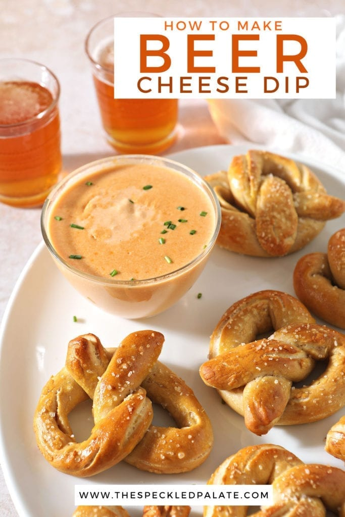 Homemade soft pretzels sit on a white tray next to a bowl of cheese sauce for pretzels and beer with the text 'how to make beer cheese dip'