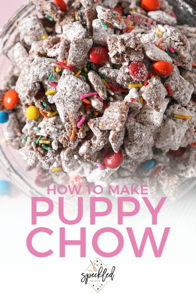 Close up of a bowl with rainbow sprinkles and chocolate-covered candies in Muddy Buddies with the text 'how to make puppy chow'