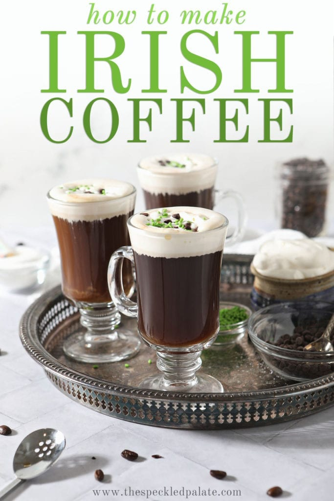 Three coffee drinks with whipped cream, chocolate and green sprinkles on a silver tray with the text 'how to make Irish coffee'