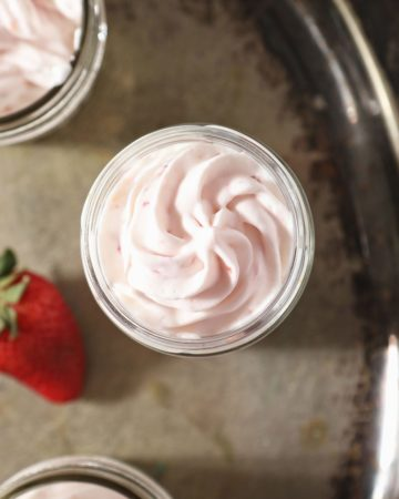 A serving of strawberry whipped cream in a glass