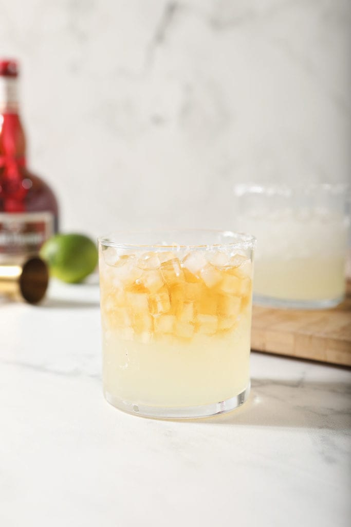 Two Cadillac Margaritas on a marble countertop